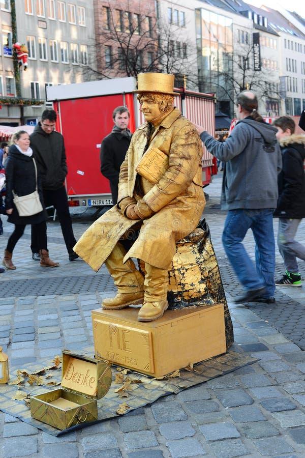 NUREMBERG - DECEMBER 6, 2015. A Street Performer imitating bronze stock images