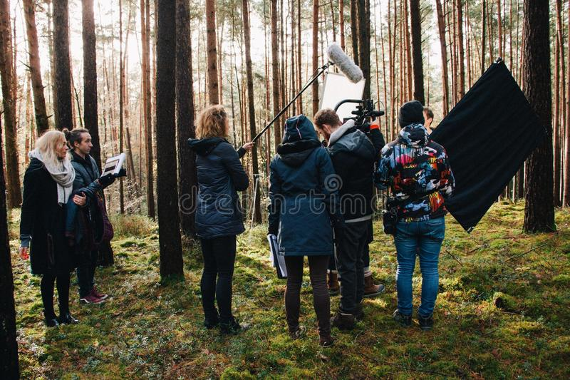 8.9.2017 Nuremberg, Germany: Behind the scene. Film crew team filming movie scene on outdoor location. Group cinema set royalty free stock images
