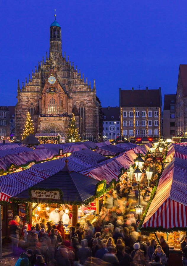 Nuremberg, Germany-Christmas Market- beautiful evening scenery. Nuremberg, Germany- beautiful evening scenery with church -crowd people, stalls side by side stock images