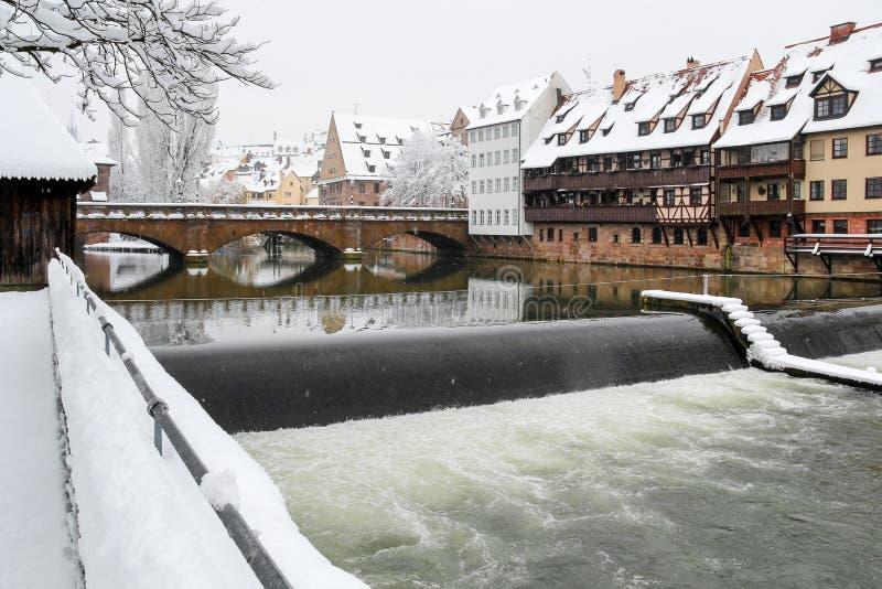 Nuremberg, Germany- Max bridge- river Pegnitz- snowy cityscape stock photos