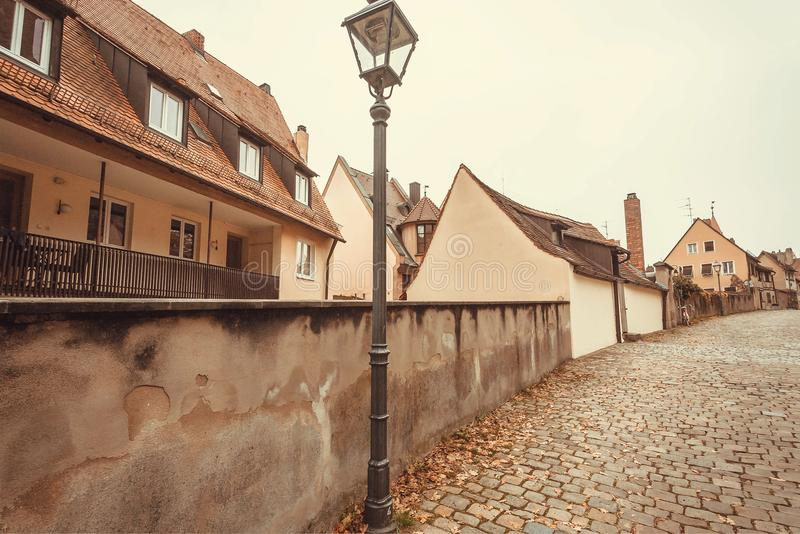 Lantern on cobbled street with houses of Bavarian city royalty free stock photos