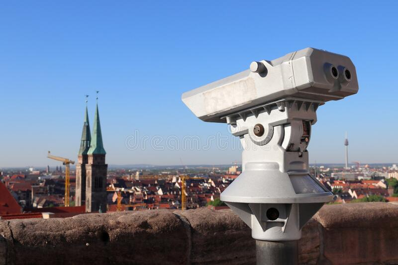Nuremberg tourist attraction. Nuremberg city, Germany. Old town viewpoint with binoculars. Tourist attraction royalty free stock image