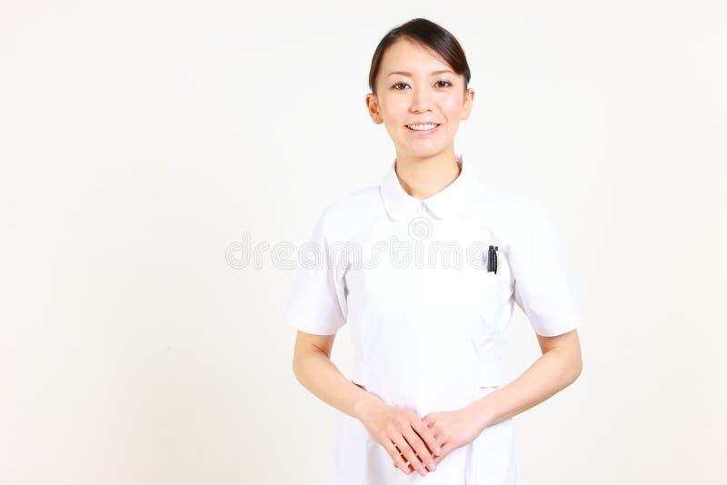 Nurse  japonés joven agradable imagen de archivo
