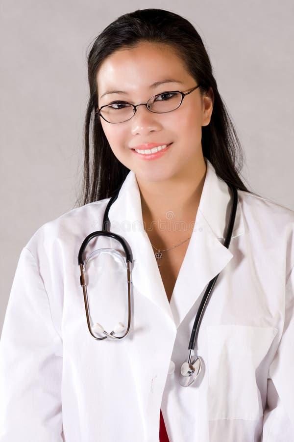 Nurse. Practitioner in white medical coat smiling stock images