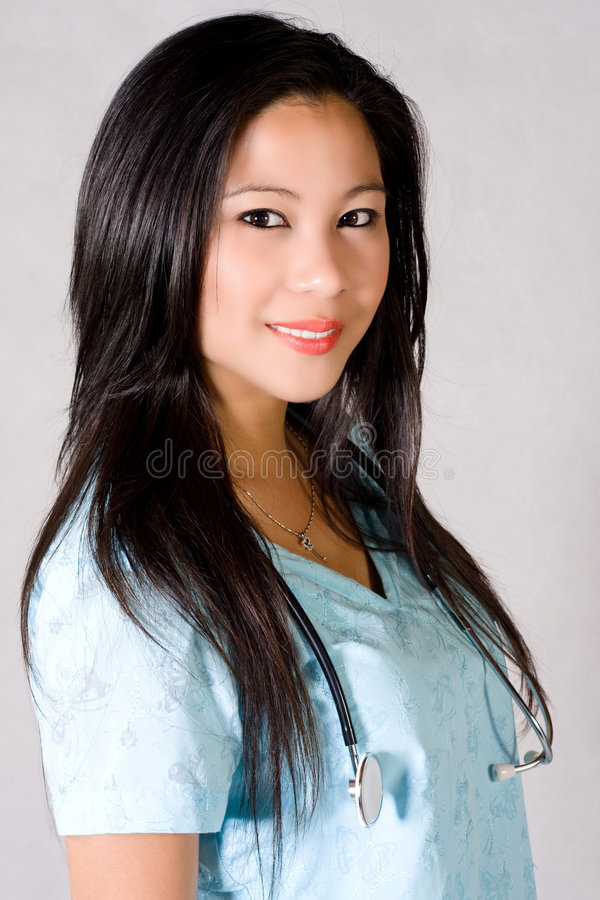 Nurse. Asian nurse in sky blue with stethoscope stock images