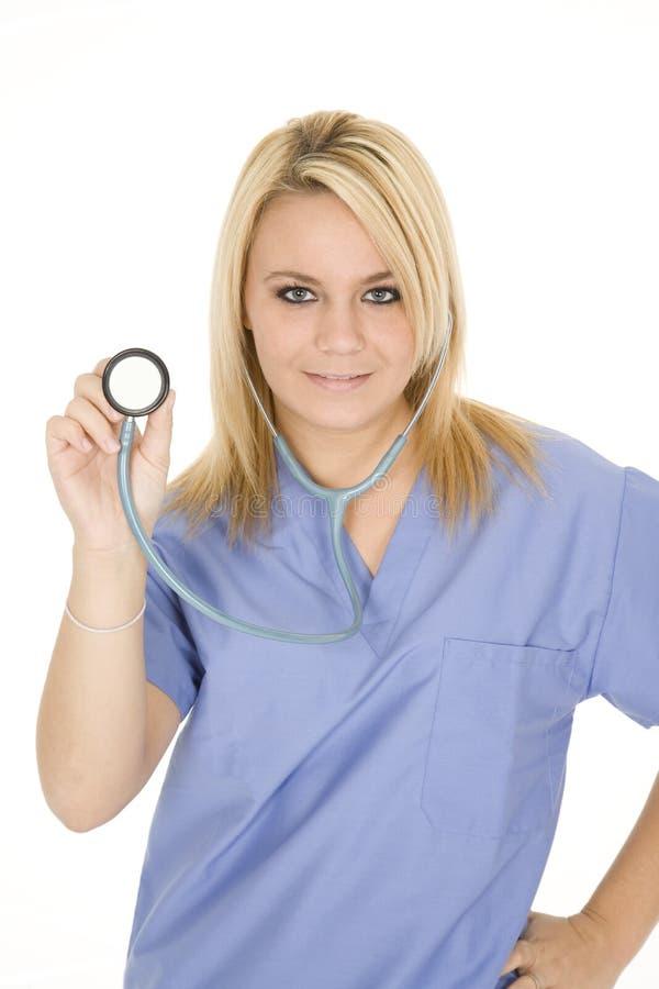 Caucasian doctor or nurse wearing blue scrubs royalty free stock photos