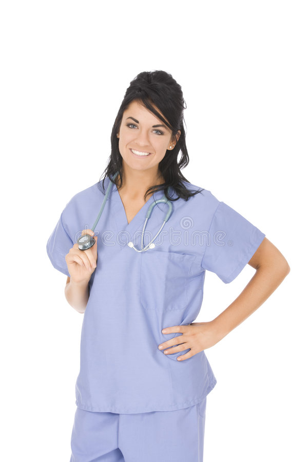 Caucasian woman doctor or nurse wearing scrubs. Beautiful Caucasian woman doctor or nurse wearing scrubs isolated on a white background stock images