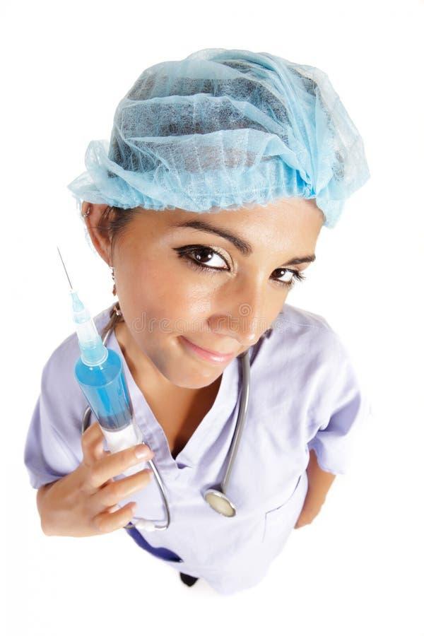 Nurse with big syringe stock photo