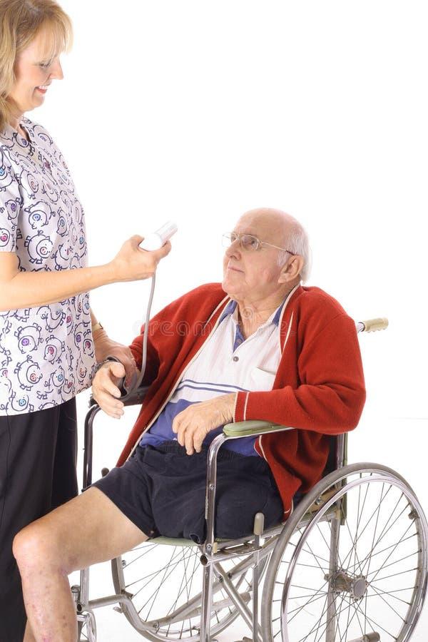 Download Nurse Checking Handicap Mans Stats Stock Photo - Image: 3980076