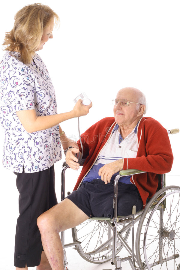 Nurse checking handicap patient. Isolated on white stock photos