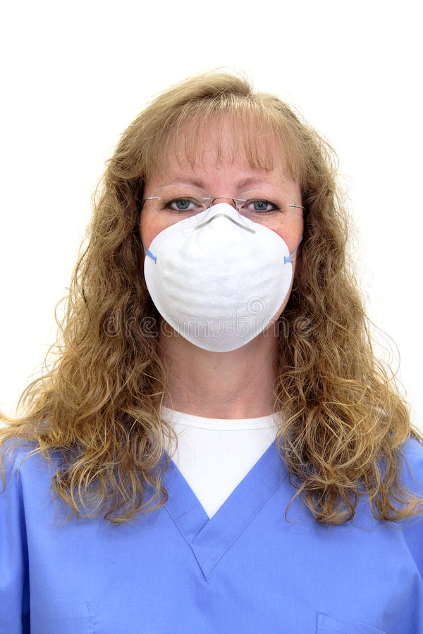 Nurse or dental hygienist wearing a mask royalty free stock photo