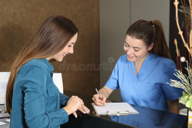Nurse or dentist attending a client. In a clinic reception stock image
