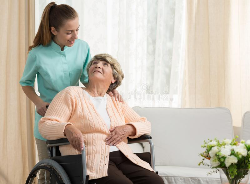 Nurse discussing with elder patient royalty free stock photo