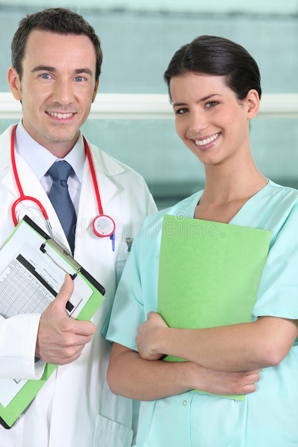 Nurse and doctor posing stock image