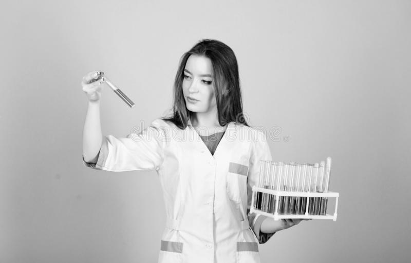 Nurse doctor scientist with test tubes. Experimental treatment concept. Cancer markers analysis. Health care. Medical. Analysis clinic. Check health with stock images