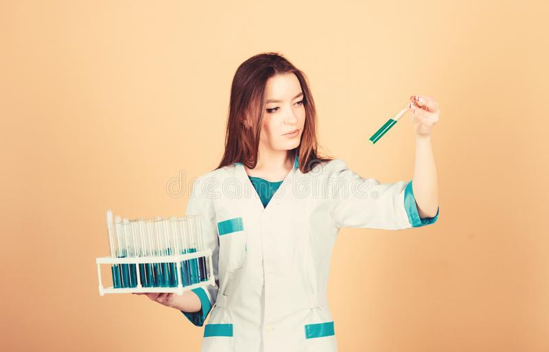 Nurse doctor scientist with test tubes. Experimental treatment concept. Cancer markers analysis. Health care. Medical royalty free stock photography