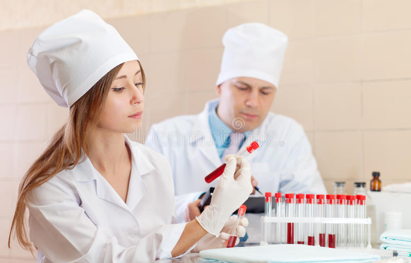 Download Nurse And  Doctor With Test Tubes Stock Photo - Image: 27195688