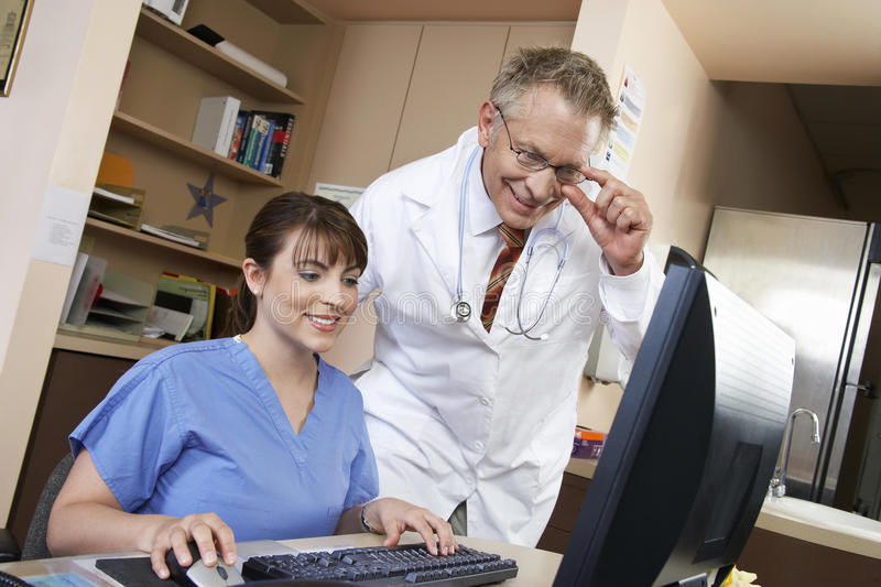 Nurse With Doctor Using Computer stock image