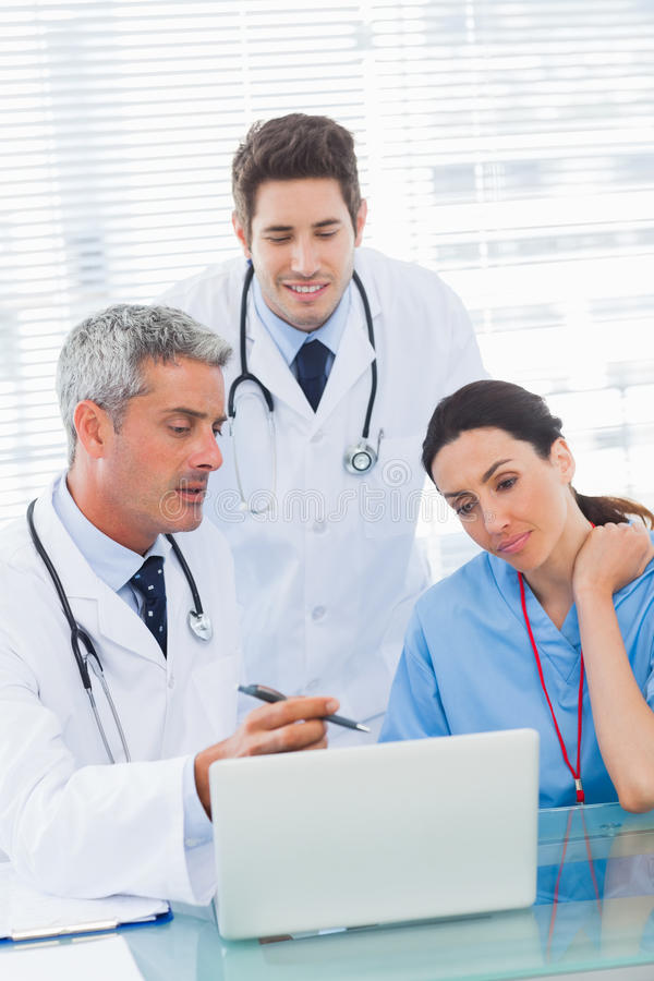 Nurse And Doctors Working Together On A Laptop Stock Photo - Image ...
