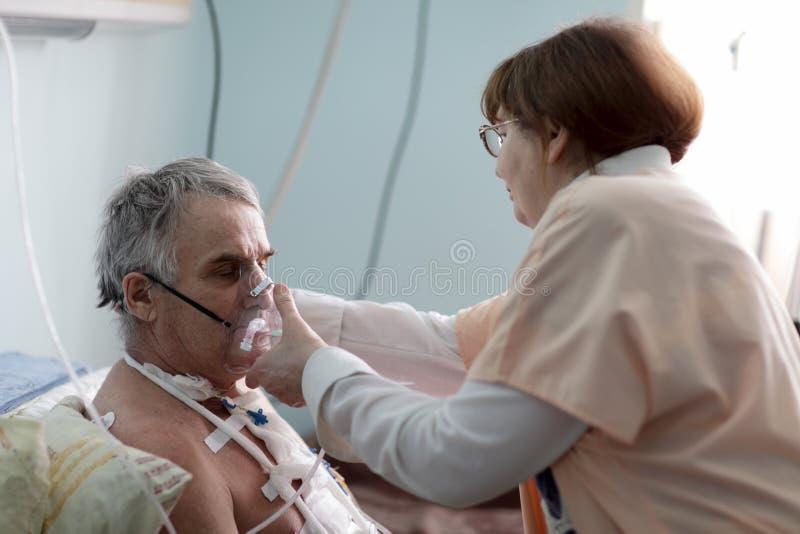 Nurse fixing oxygen mask royalty free stock image