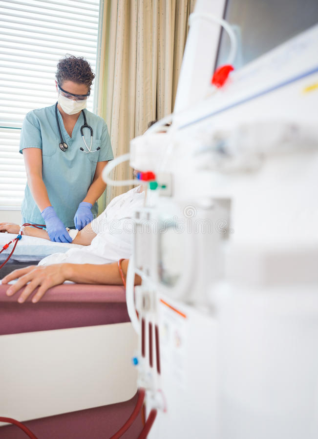 Nurse Giving Renal Dialysis Treatment To Patient stock image