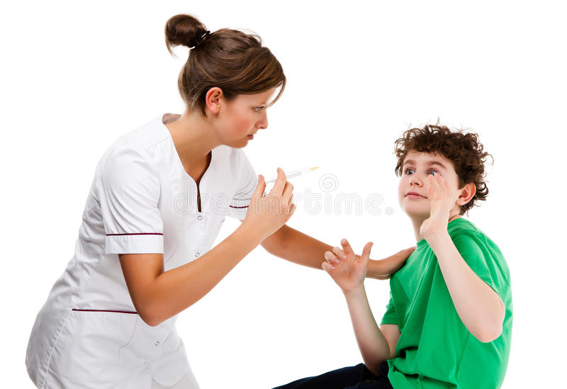 Nurse giving young boy injection isolated on white background royalty free stock images
