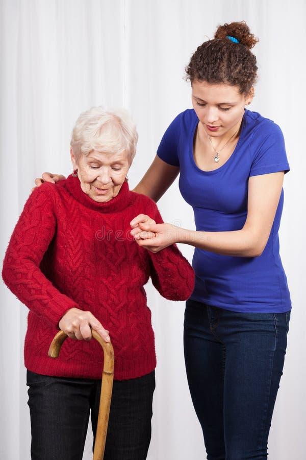 Nurse helping elderly lady walk stock photos