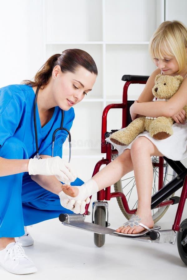 Nurse helping patient stock photos