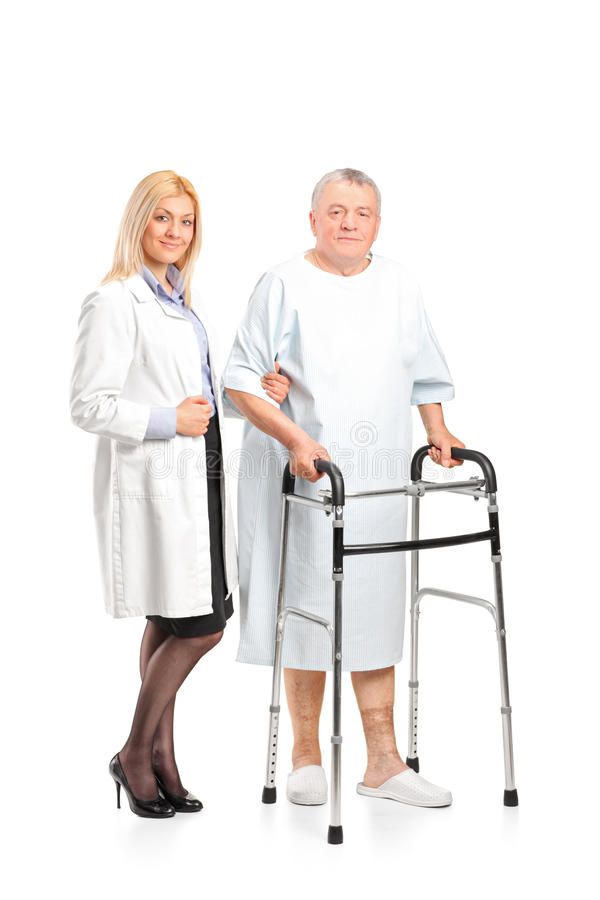 Download Nurse Helping A Patient To Use A Walker Stock Photo - Image: 23470172