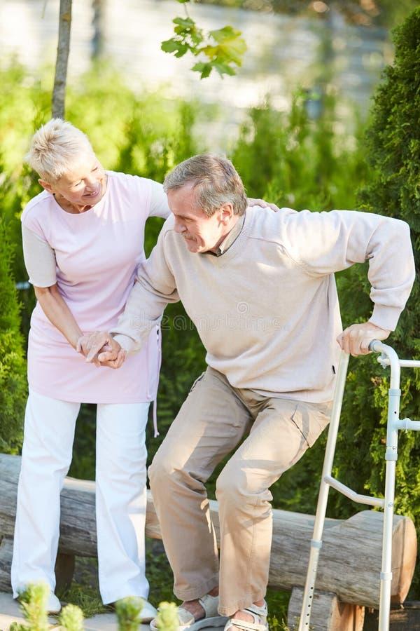 Nurse Helping Senior Patient stock image