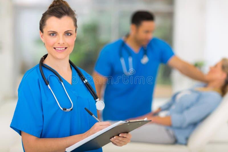 Nurse holding clipboard. Portrait of gorgeous nurse holding clipboard royalty free stock photo