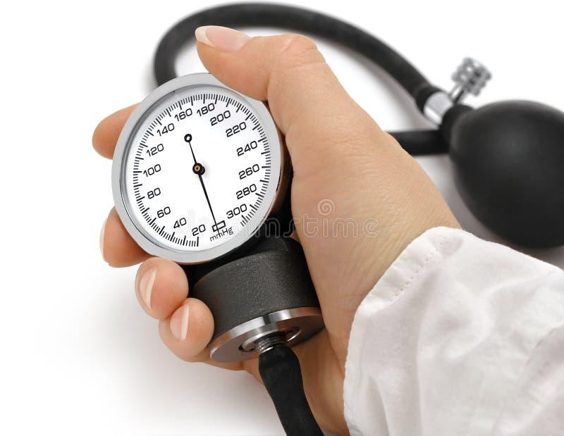 Nurse holding manometer. On a white background royalty free stock photography