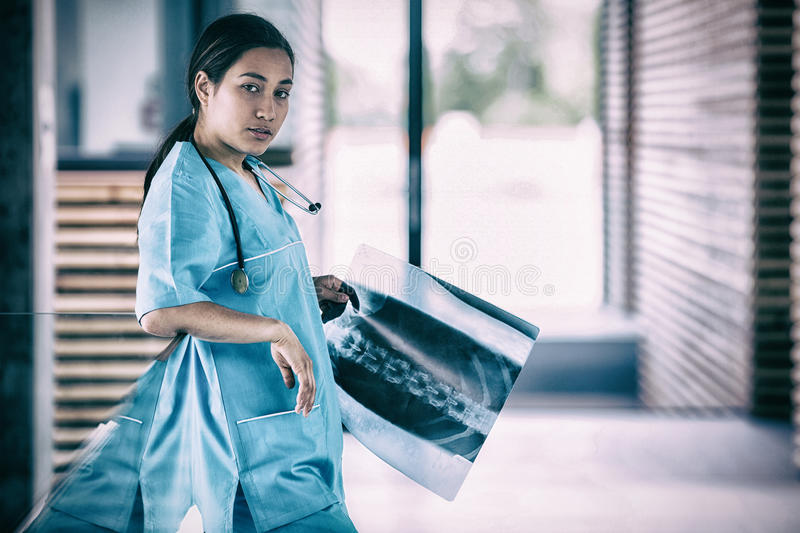 Nurse holding X-ray report. Portrait of nurse holding X-ray report in hospital royalty free stock photos