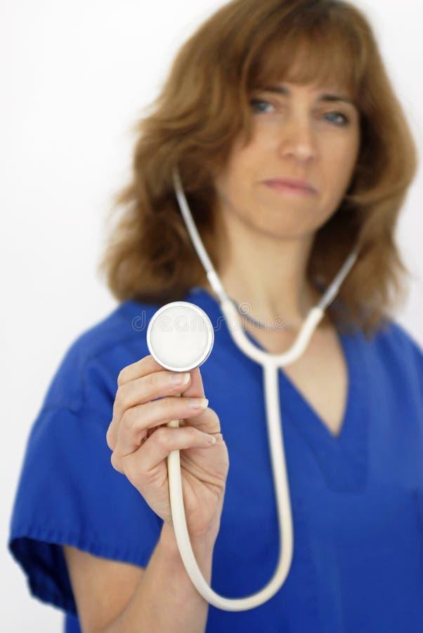 Nurse Holding White Stethoscope stock image