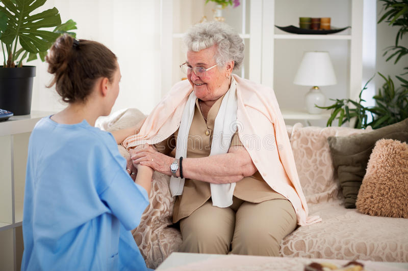 Nurse in home visit stock photography