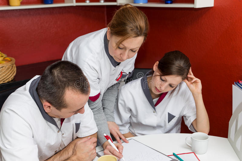 Nurse instructs other employees stock images