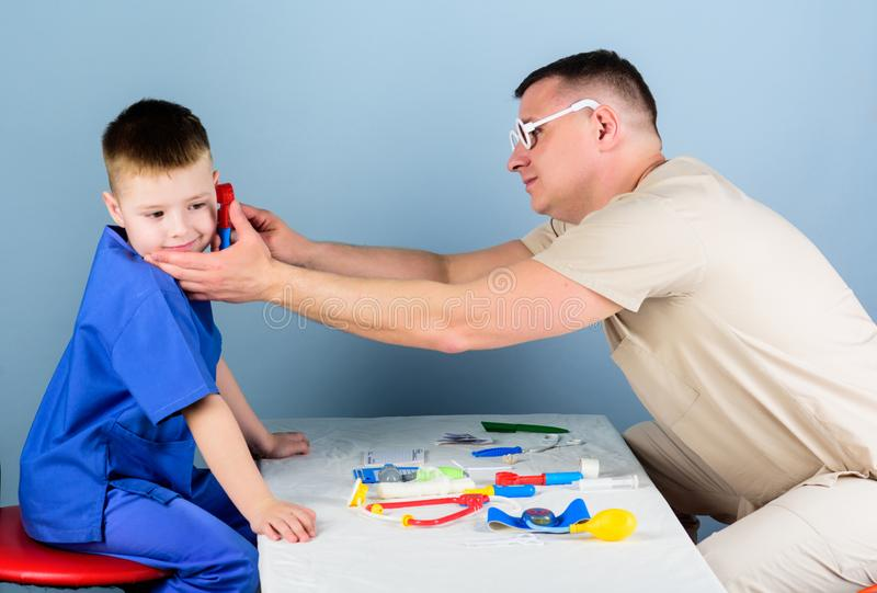 Nurse laboratory assistant. family doctor. small boy with dad play. Future career. happy child with father with. Stethoscope. medicine and health. father and royalty free stock images