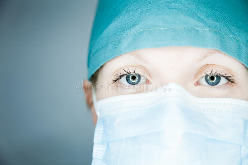 Nurse looking at you. Studio shot stock image