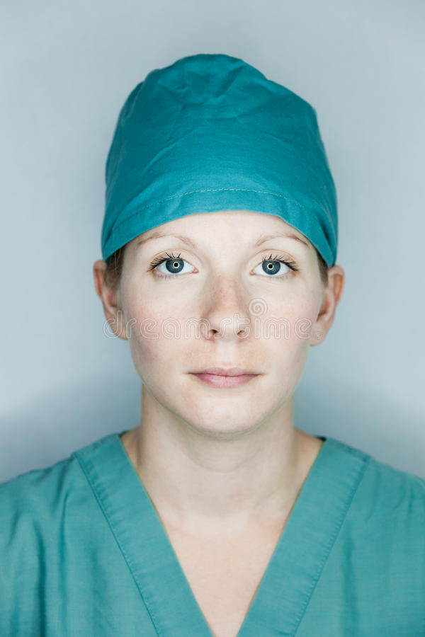 Nurse looking at you (straight portrait). Studio shot stock image