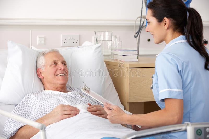 Nurse And Male Patient In Uk Ae Stock Photo - Image Of Female, Medical 23958918-9943