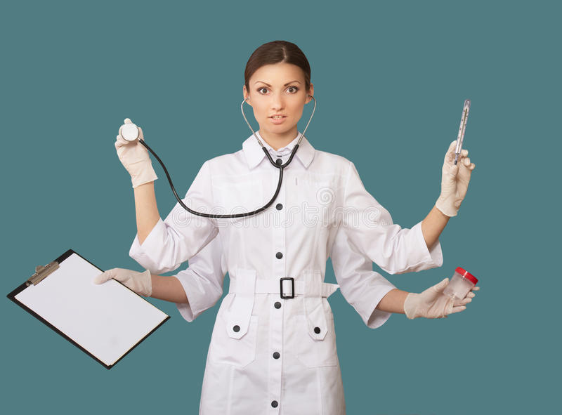 Nurse with many hands. Studio portrait of a nurse with many hands, concept royalty free stock photo