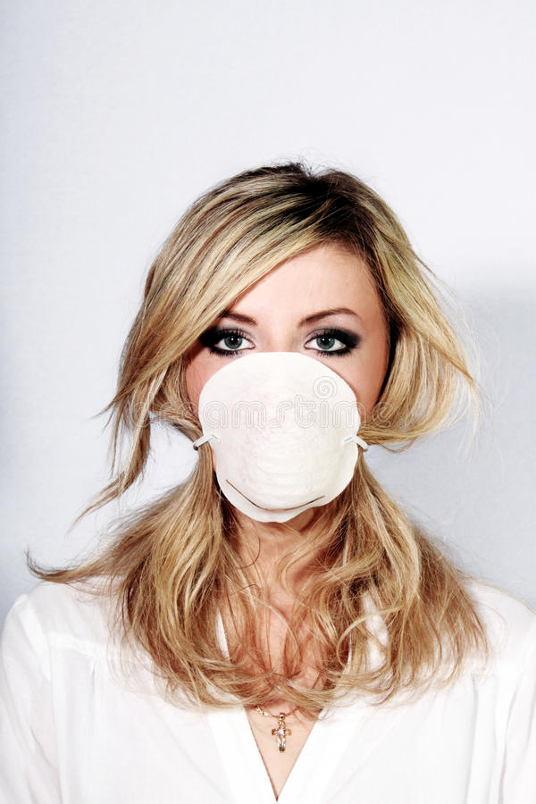 Nurse in a mask. Young beautiful nurse in mask stock photo