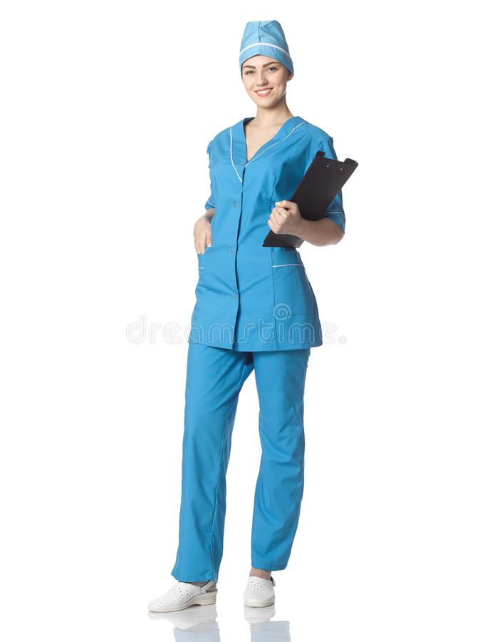 A nurse or medical student holds a file folder, stands in full g royalty free stock photo