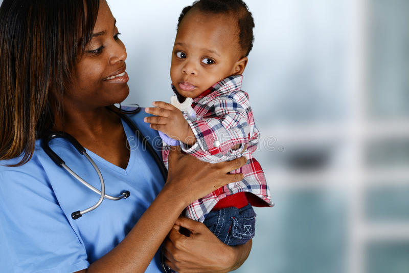 Nurse. Minority nurse working at her job in a hospital with family royalty free stock image