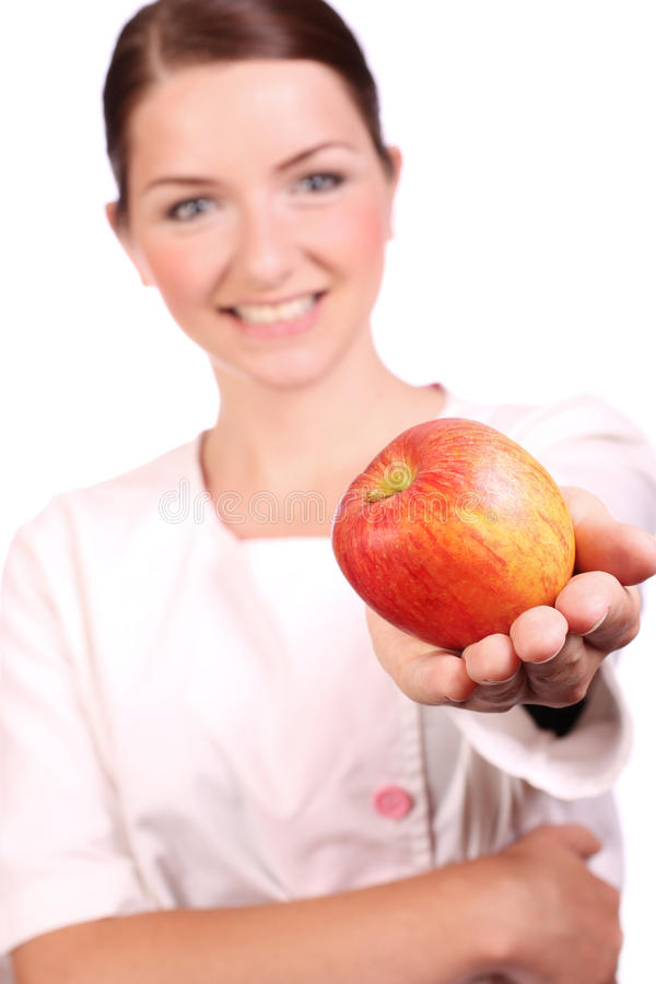 Download Nurse Offering An Appleto The Camera Stock Image - Image of caucasian, eyes: 9890773