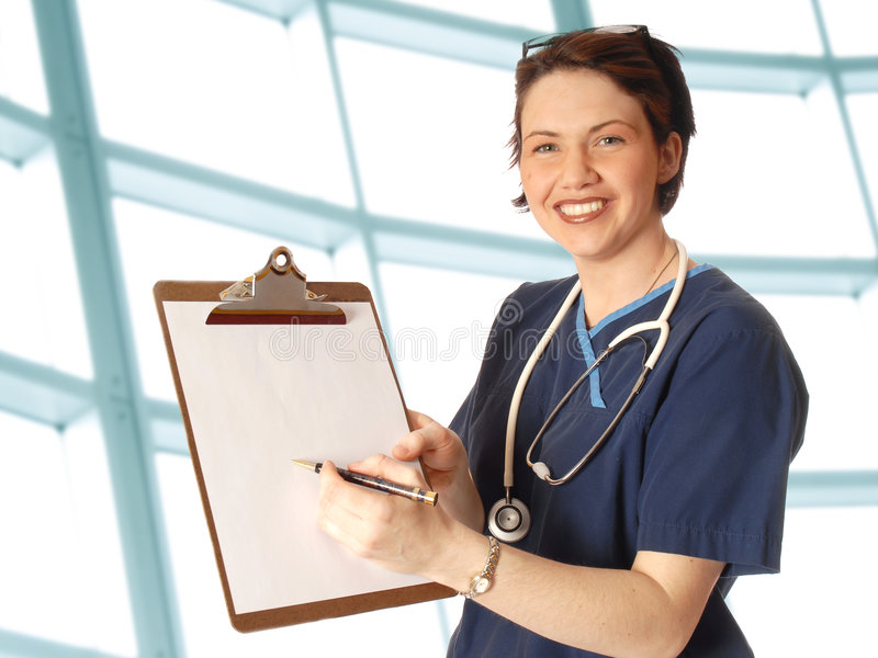 Nurse with pad. Doctor in blue scrubs with a note pad royalty free stock photography