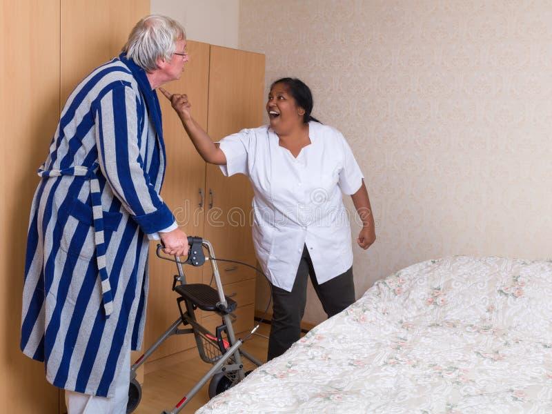 Nurse patient fight stock photos