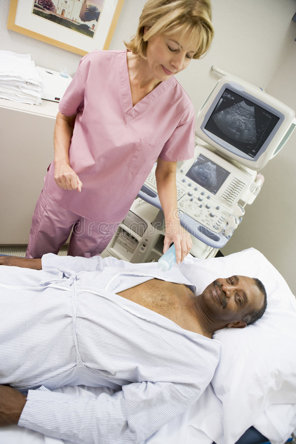 Nurse With Patient Having Ultrasound Scan royalty free stock photo