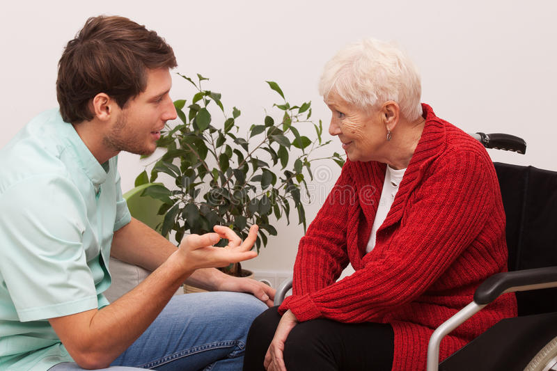 Nurse and patient. Nurse keeping company to disabled elderly lonley person stock images