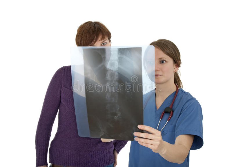 Nurse and patient looking at x-ray, worried. Nurse and patient looking at x-ray with worried expression, on white background stock image